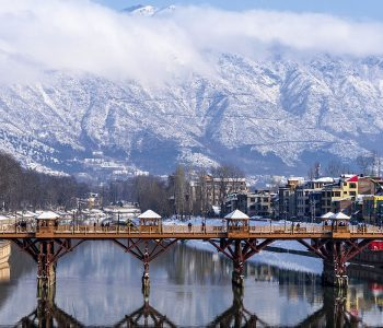 Beautiful scenery of Zero bridge with Himalaya mountain covered with snow in the background.